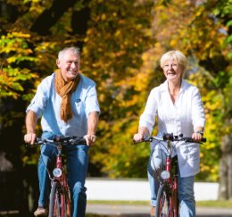Photograph of a couple riding bikes